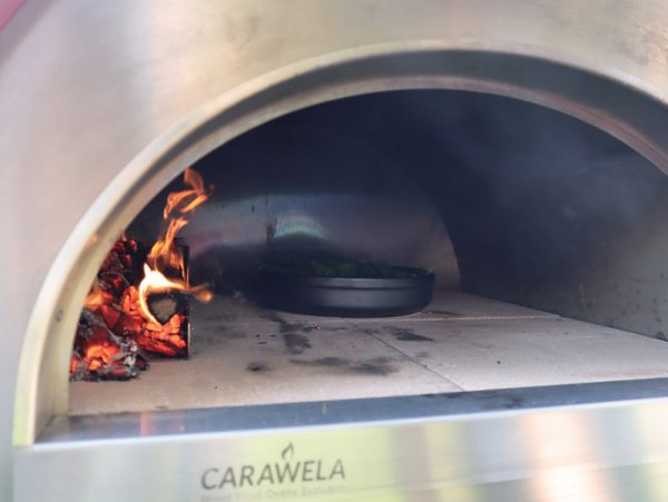 Pro600 wood fired oven - cooking spinaches